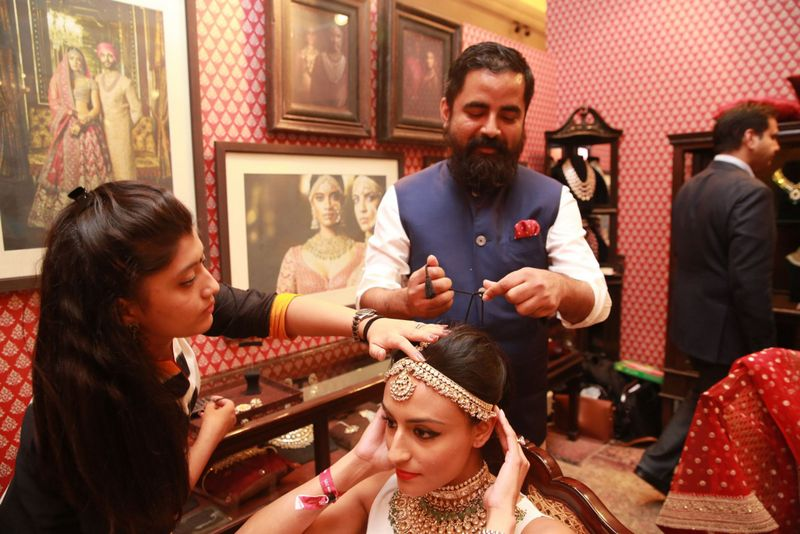 Sabyasachi with a bride-to-be trying out the jewellery by Kishandas & Company for Sabyasachi at Vogue Wedding Show 2015 at Taj Palace, New Delhi - Copy