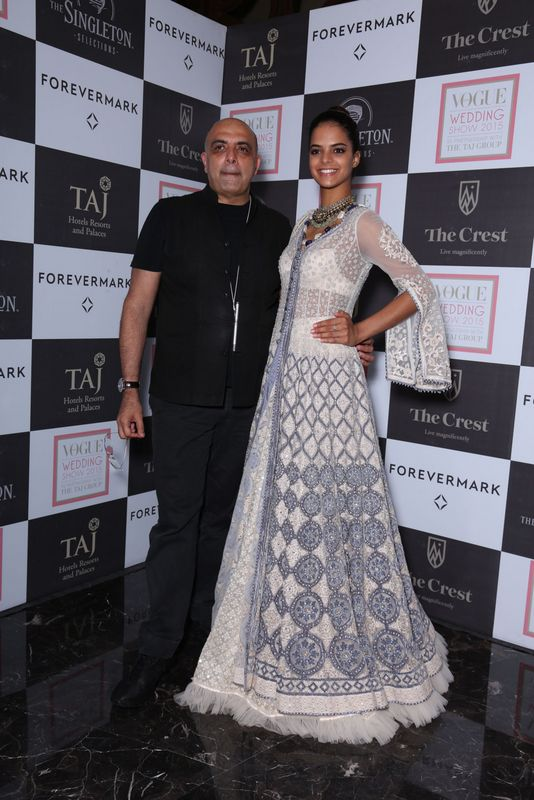 Tarun Tahiliani with a model in his creation at Day 1 of the Vogue Wedding Show 2015, at Taj Palace, New Delhi - Copy