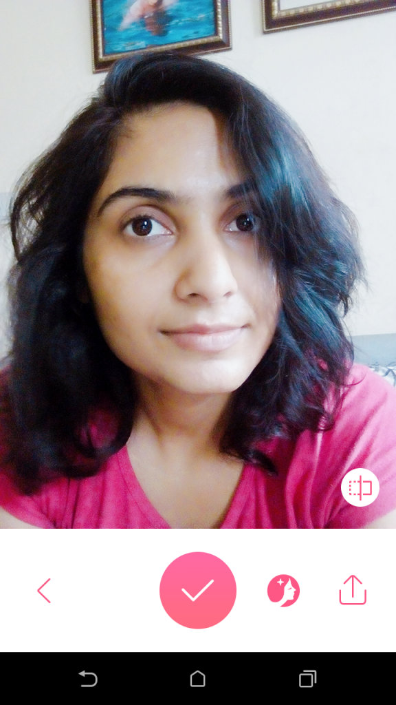 Selfie taken with no makeup on and in bad lighting, looks better with this app!